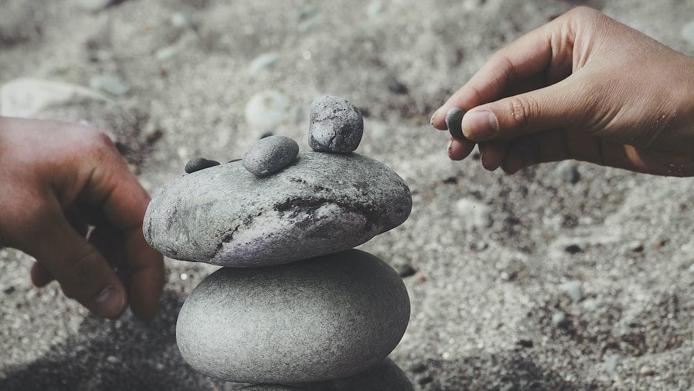 person balancing rocks