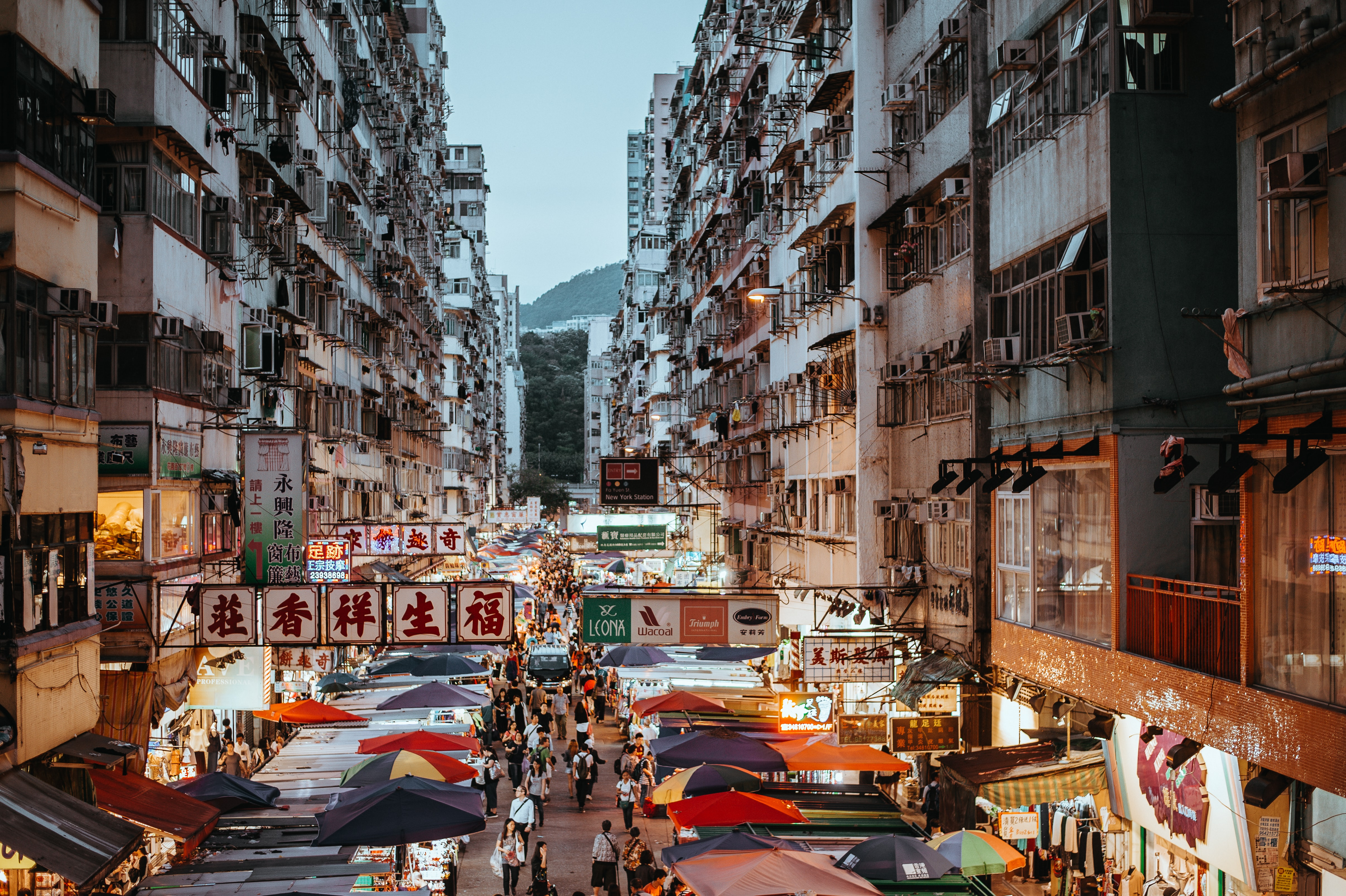 A high shot of a busy street with a marketplace in Hong Kong