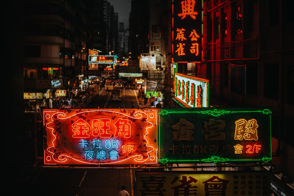 assorted lit kanji script LED signages on buildings during nighttime