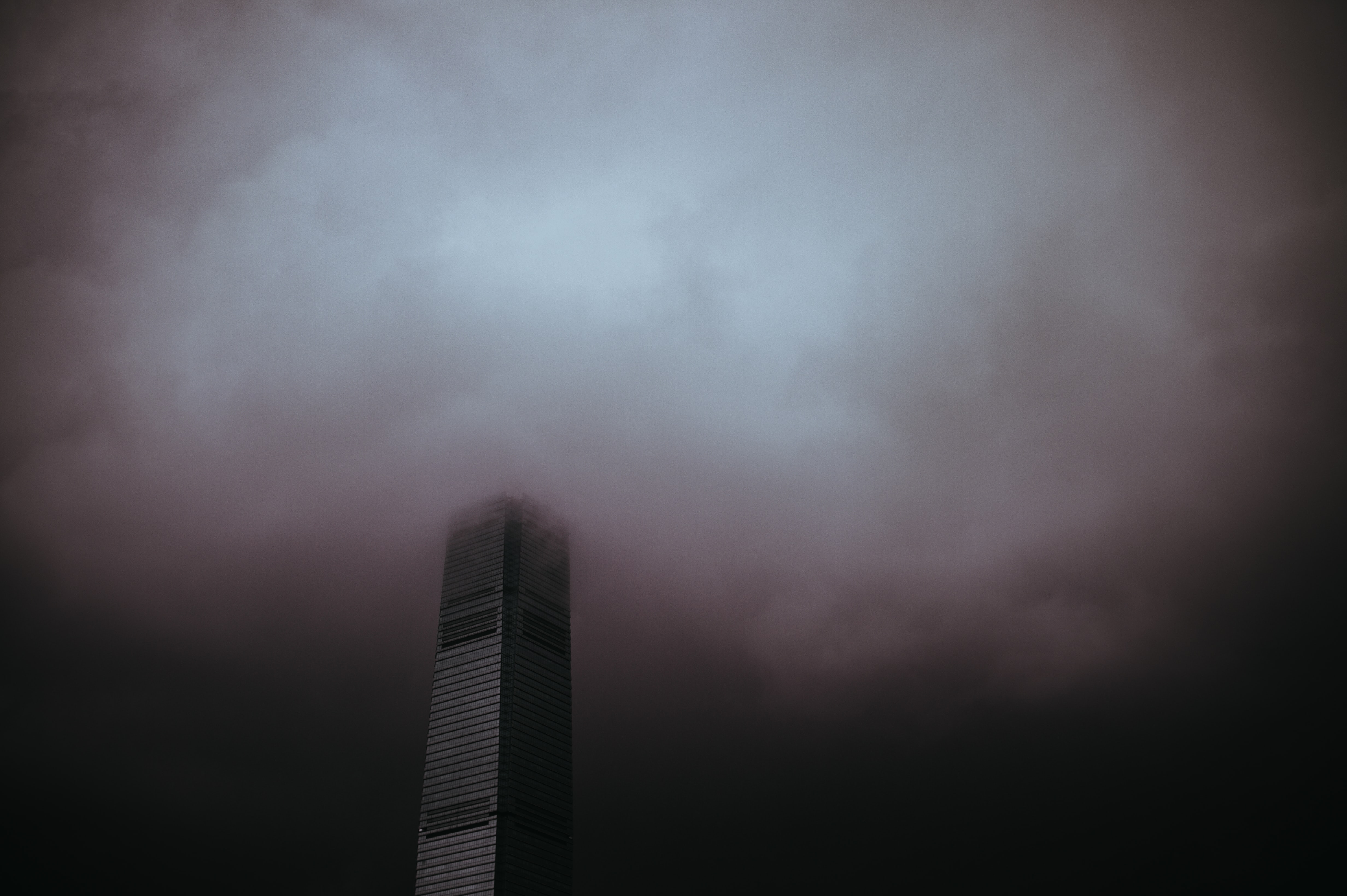 high-rise building under gray sky