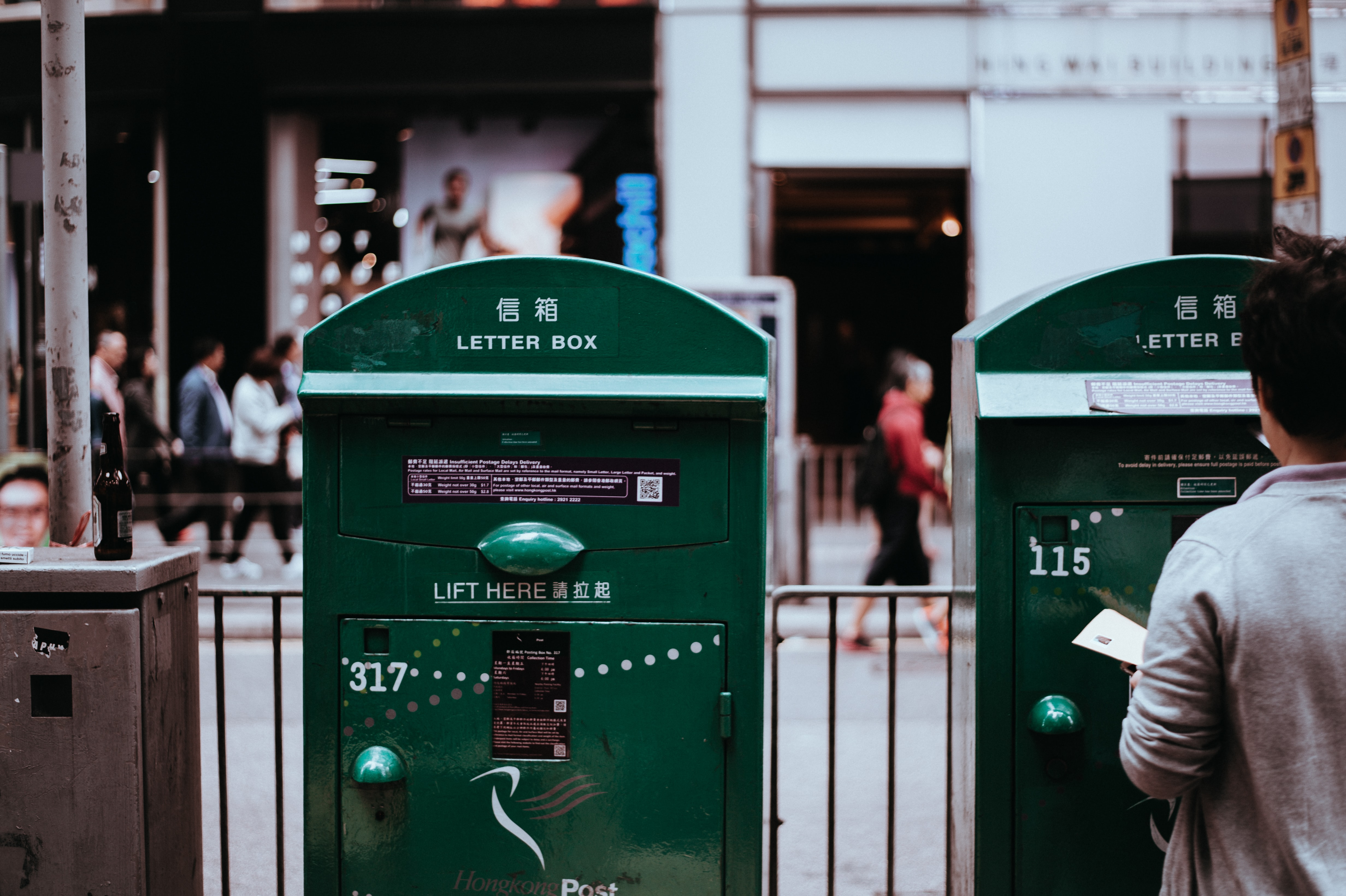 Two green letter boxes in urban area of Hong Kong
