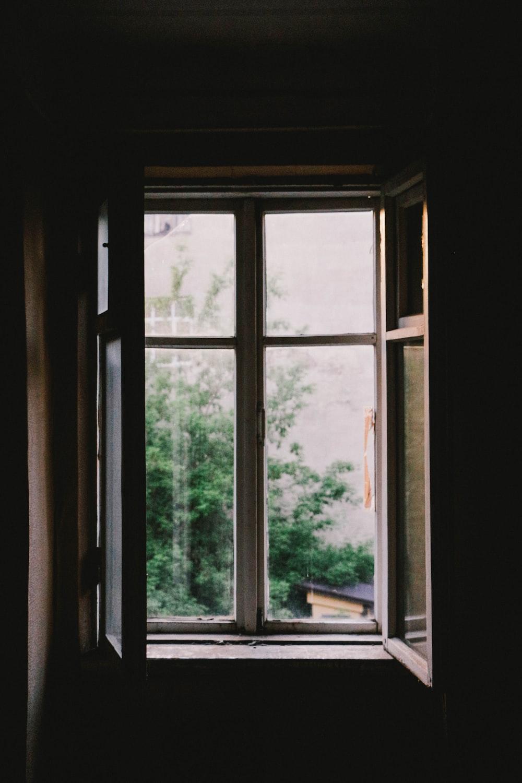 open casement window near plants