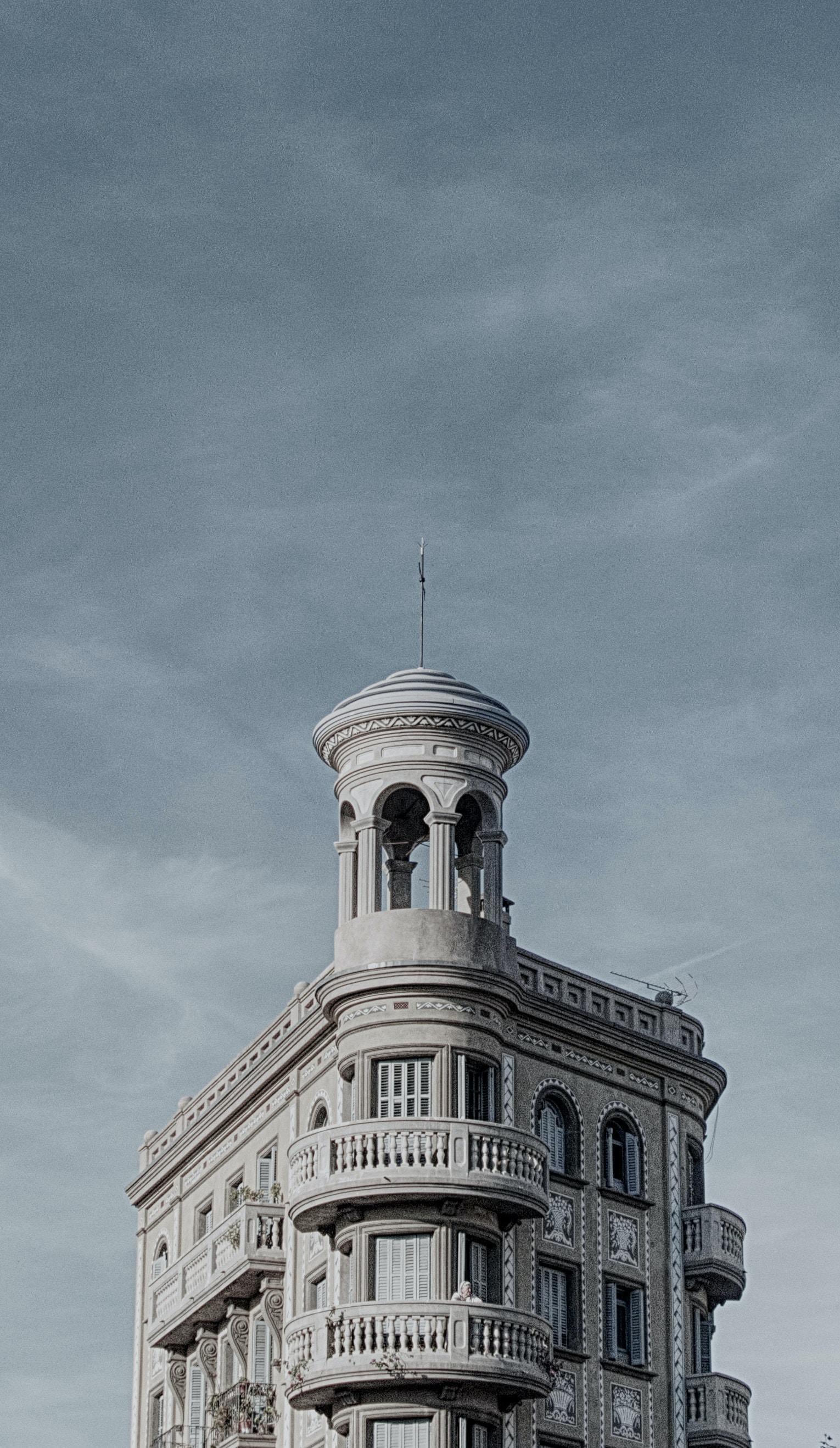 concrete building under cloudy sky