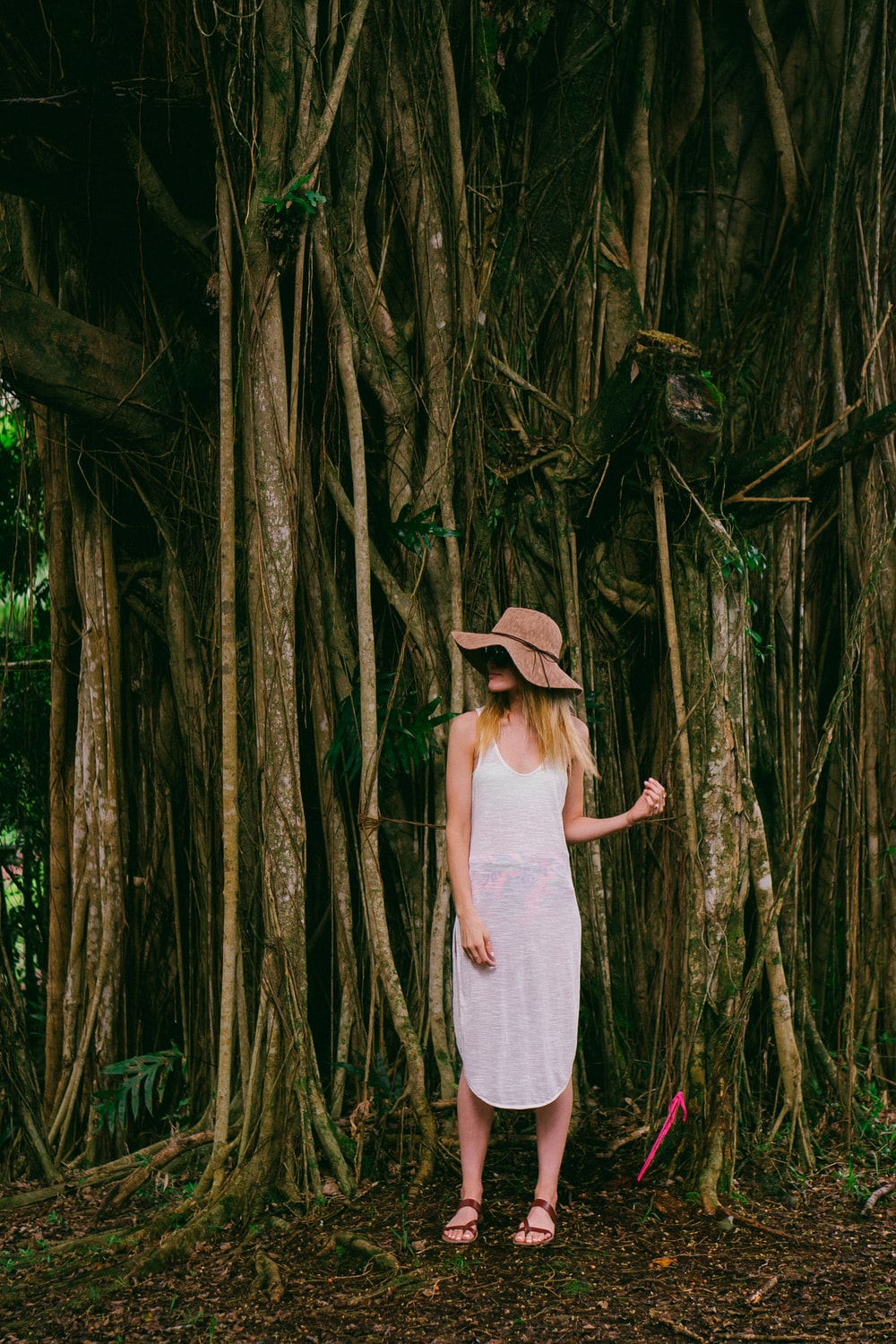 woman standing near tree