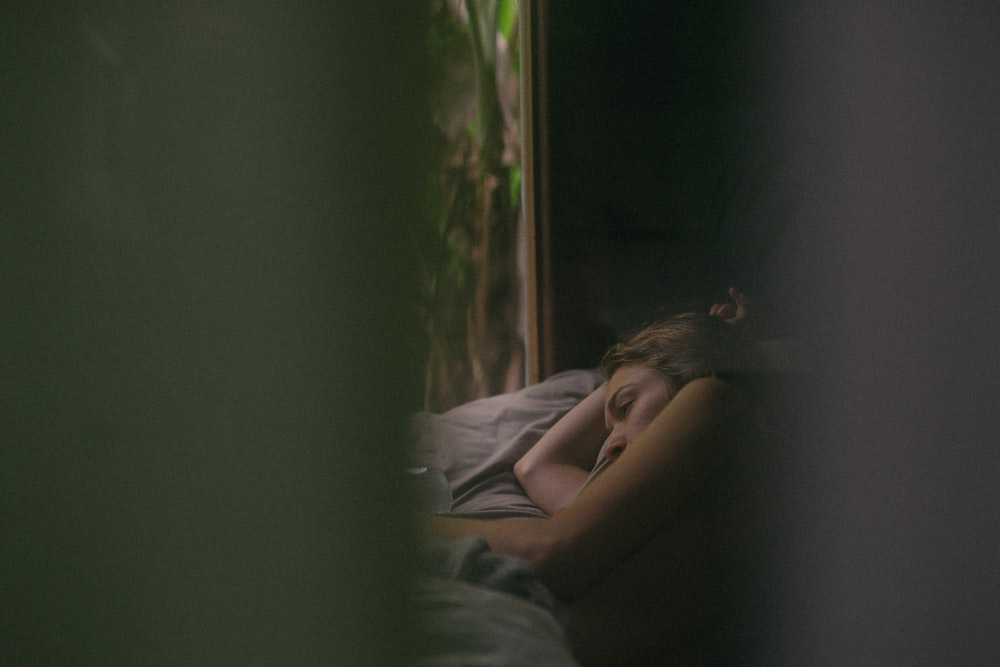 Photo through peephole of woman resting on a bed