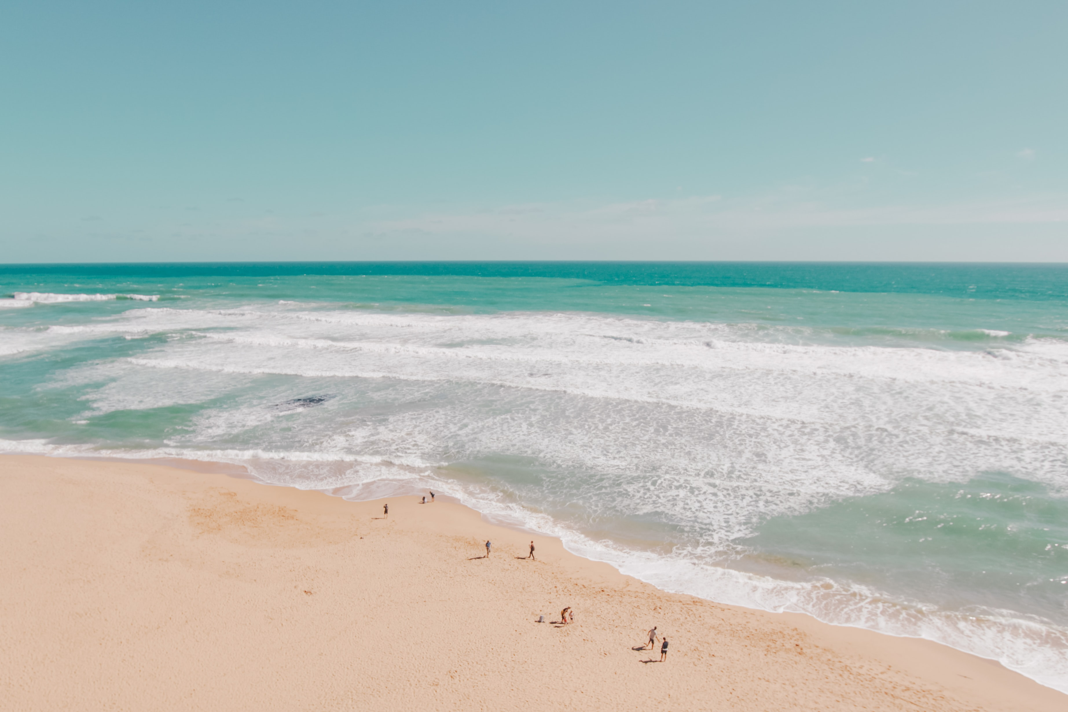 Drone view of the people on the sand beach at Great Ocean Road