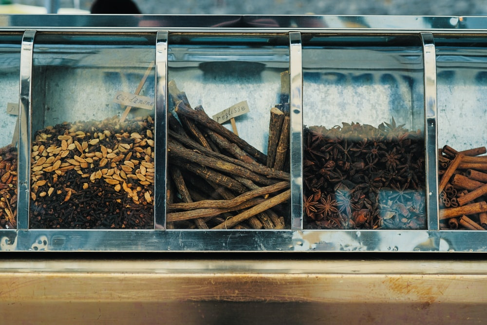 focus photography of assorted spices on display counter