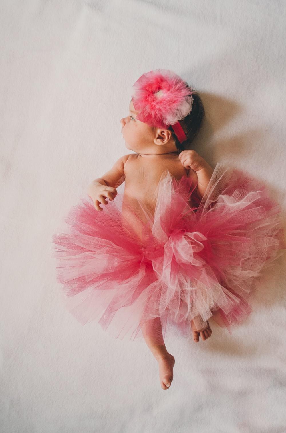baby wearing pink tutu dress