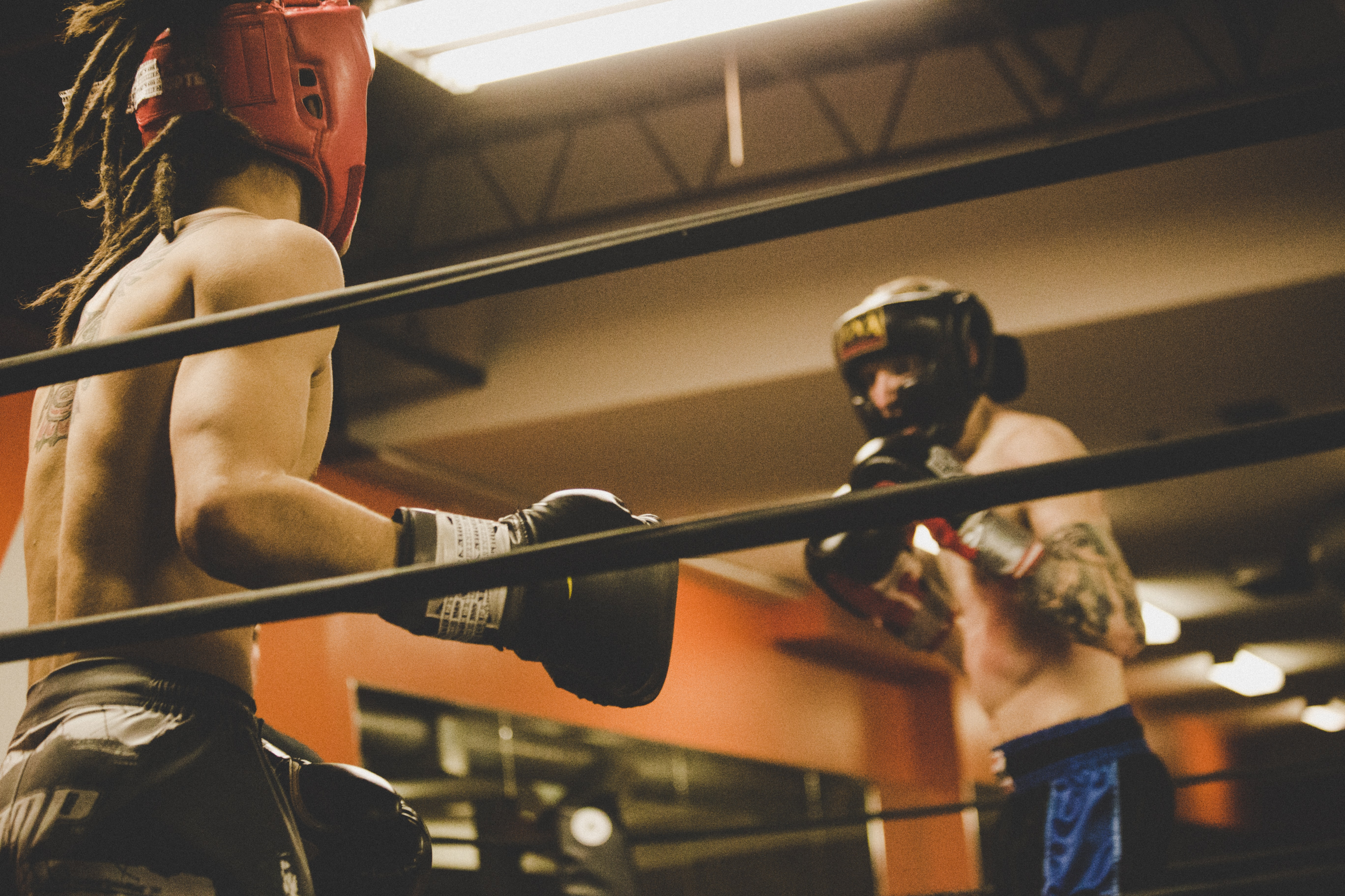 Two kickboxers are fighting in the ring in London.