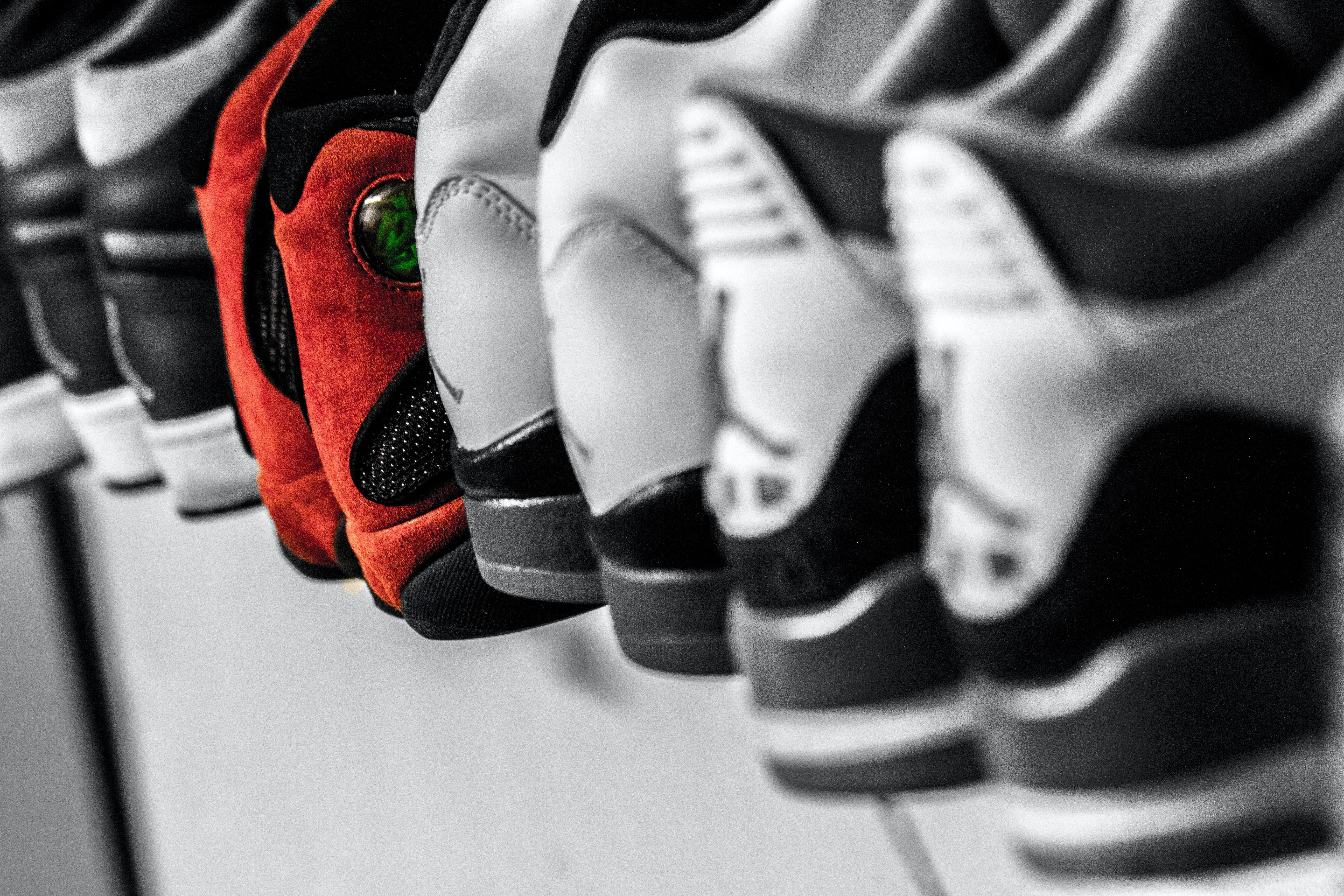 Black and white Air Jordan sneakers sit on either side of red Air Jordan sneakers