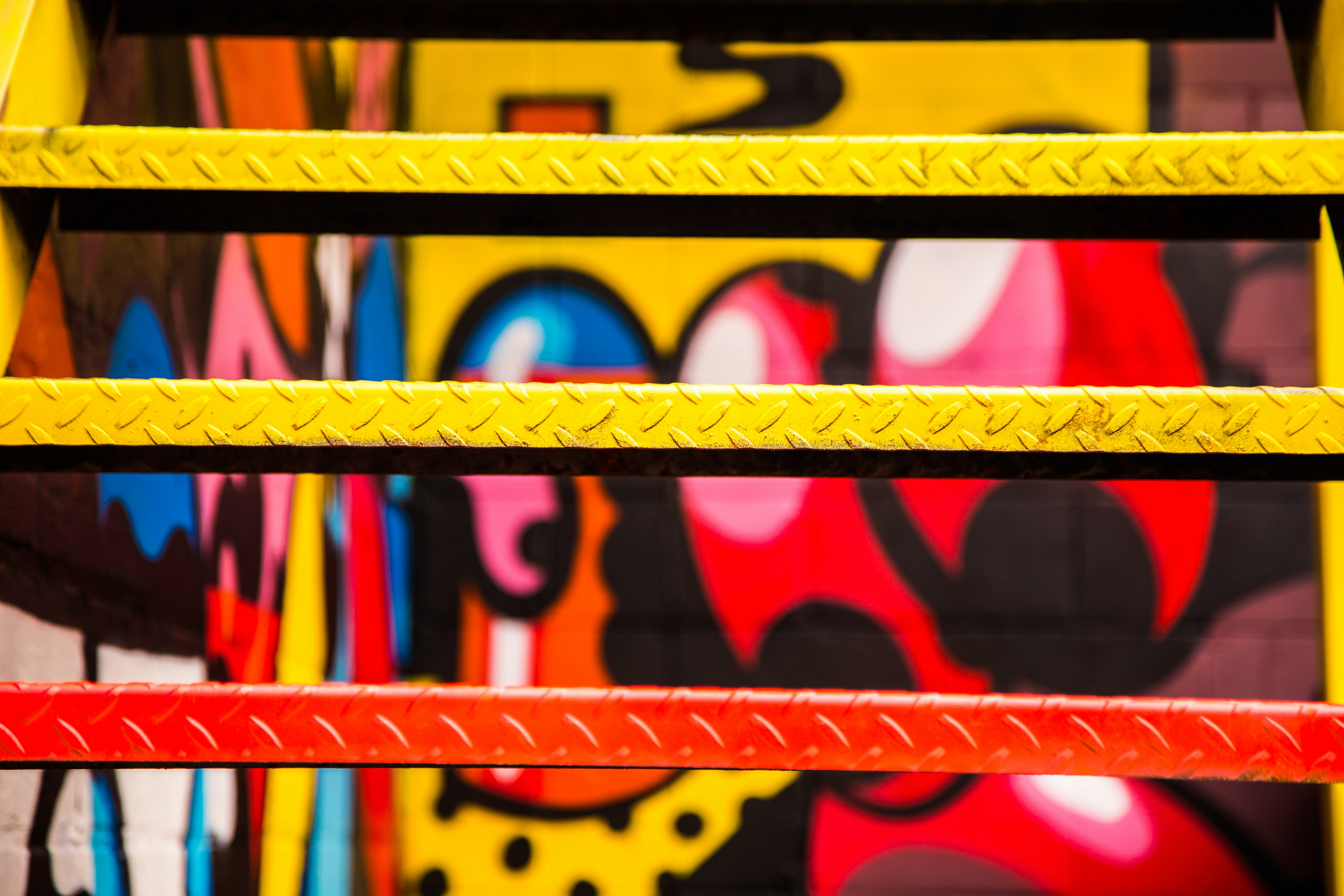 Close up of spray painted metal urban stairs with colorful graffiti in background, Windsor