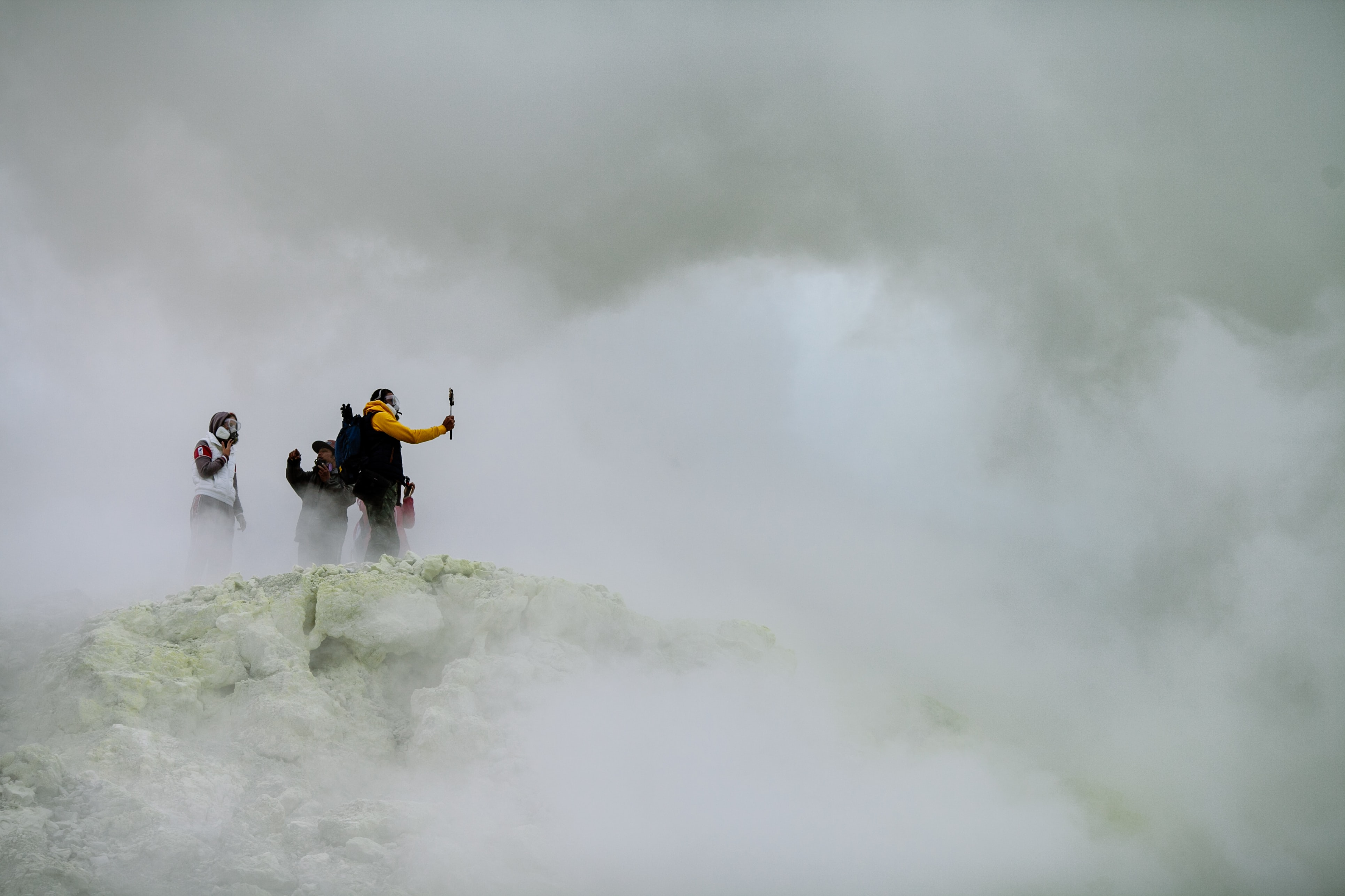 three people on mountain