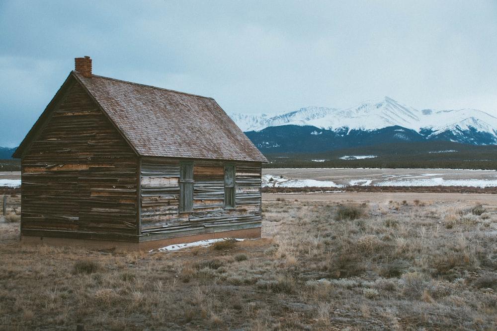 brown barn on field
