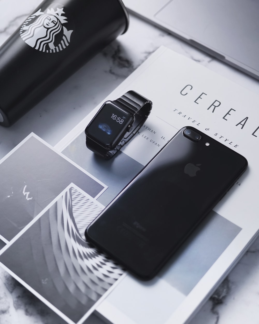 space gray iPhone 8 Plus beside space black aluminum case Apple Watch