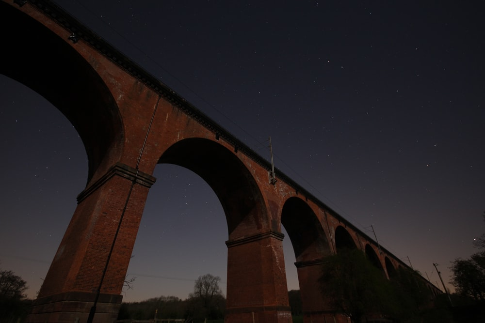 brown concrete bridge under sky