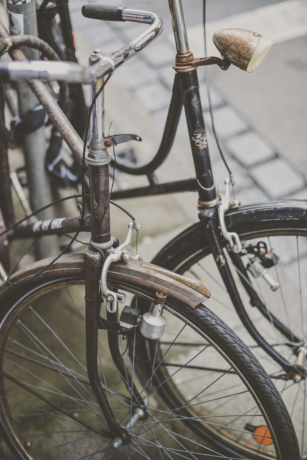 two brown and black commuter's bicycles