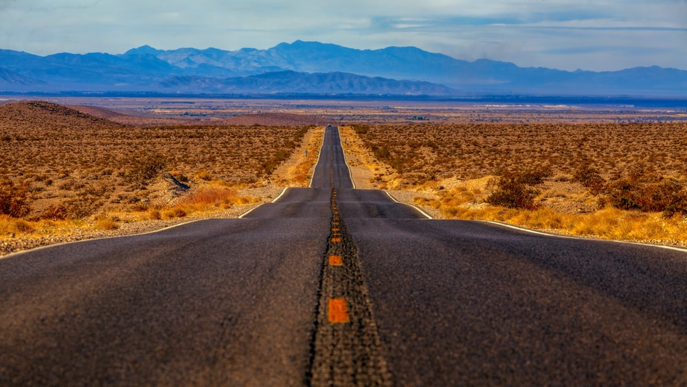 Empty highway road in through a colorful desert