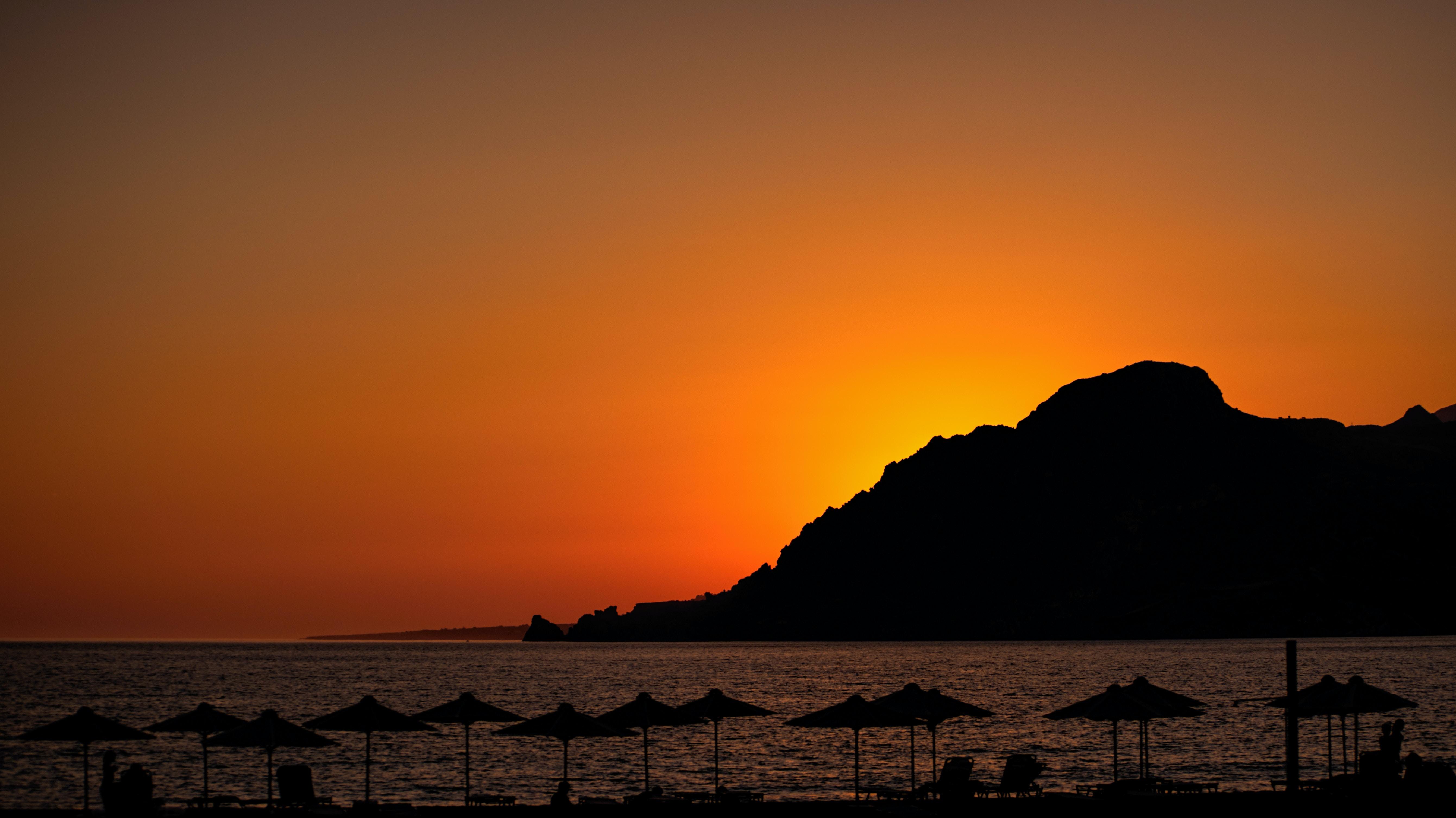silhouette of mountain during sun set