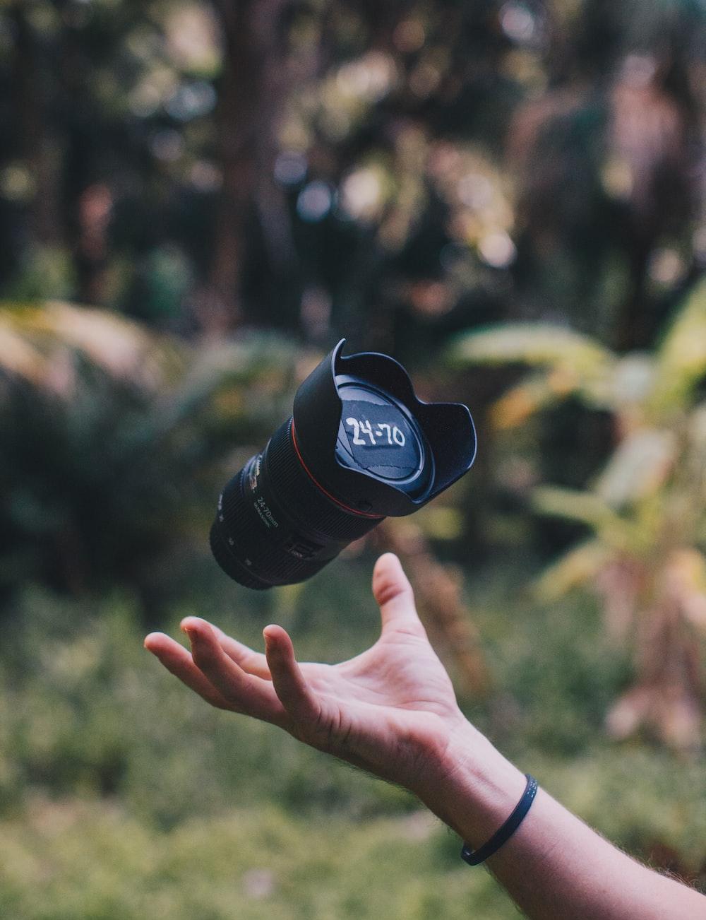 shallow focus photo of black DSLR camera lens