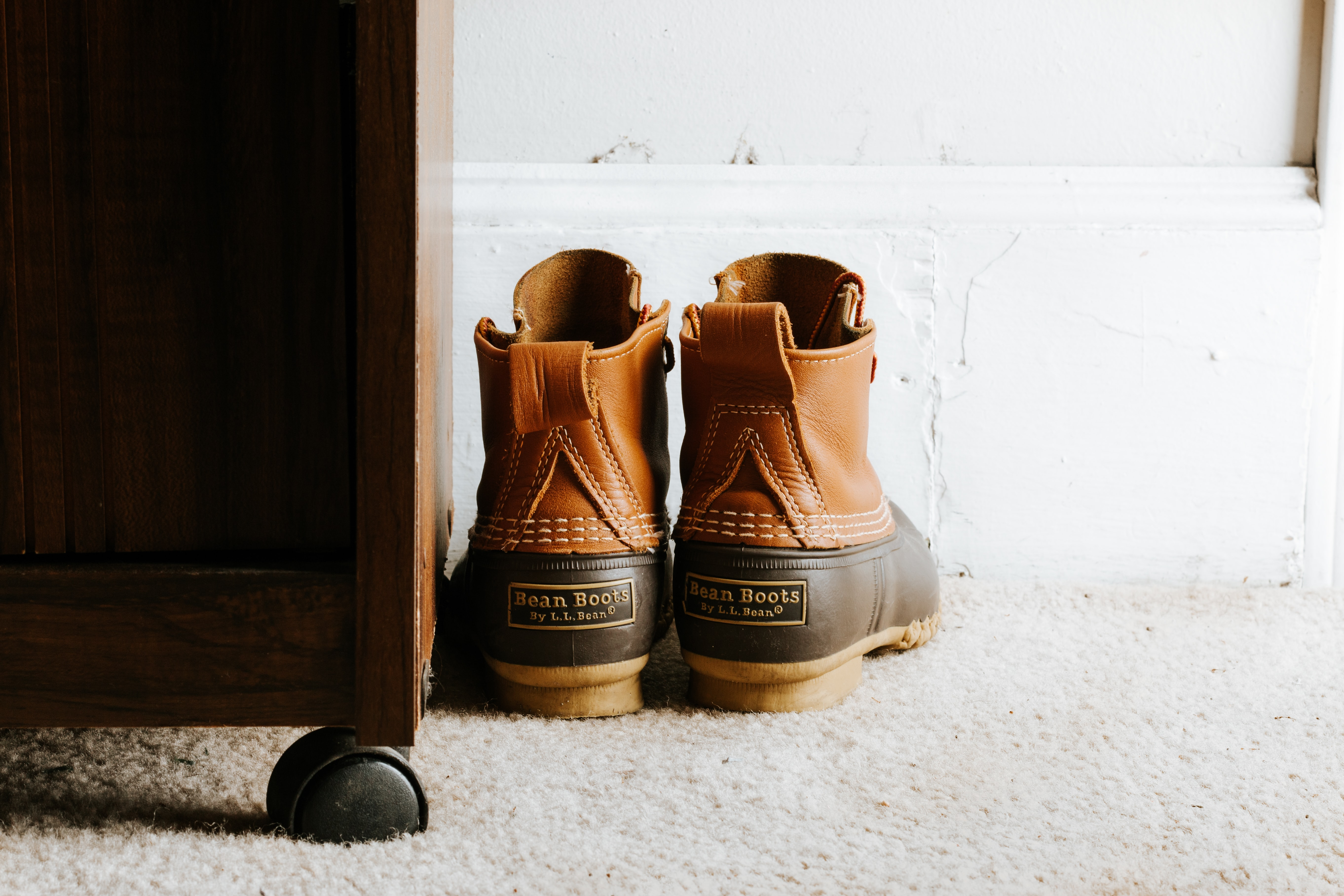 Working boots on the carpet in a bedroom