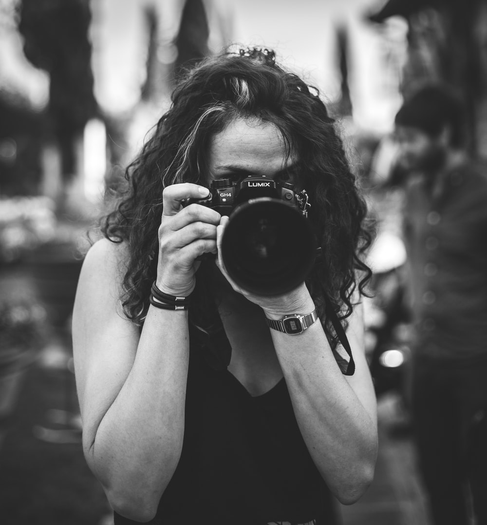 woman holding Lumix camera