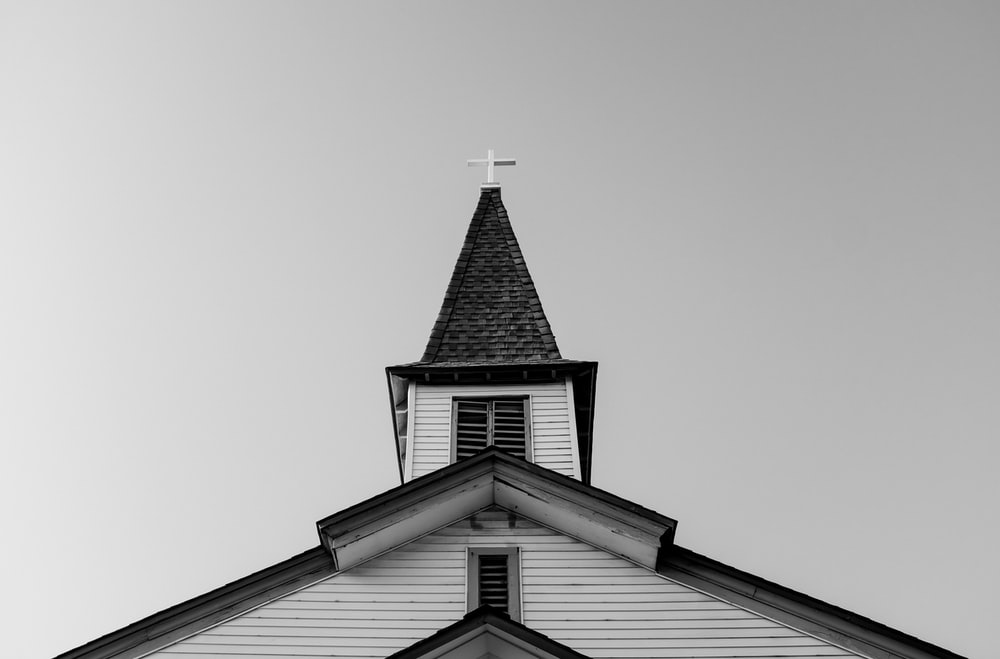 white and black concrete chapel in low angle photography