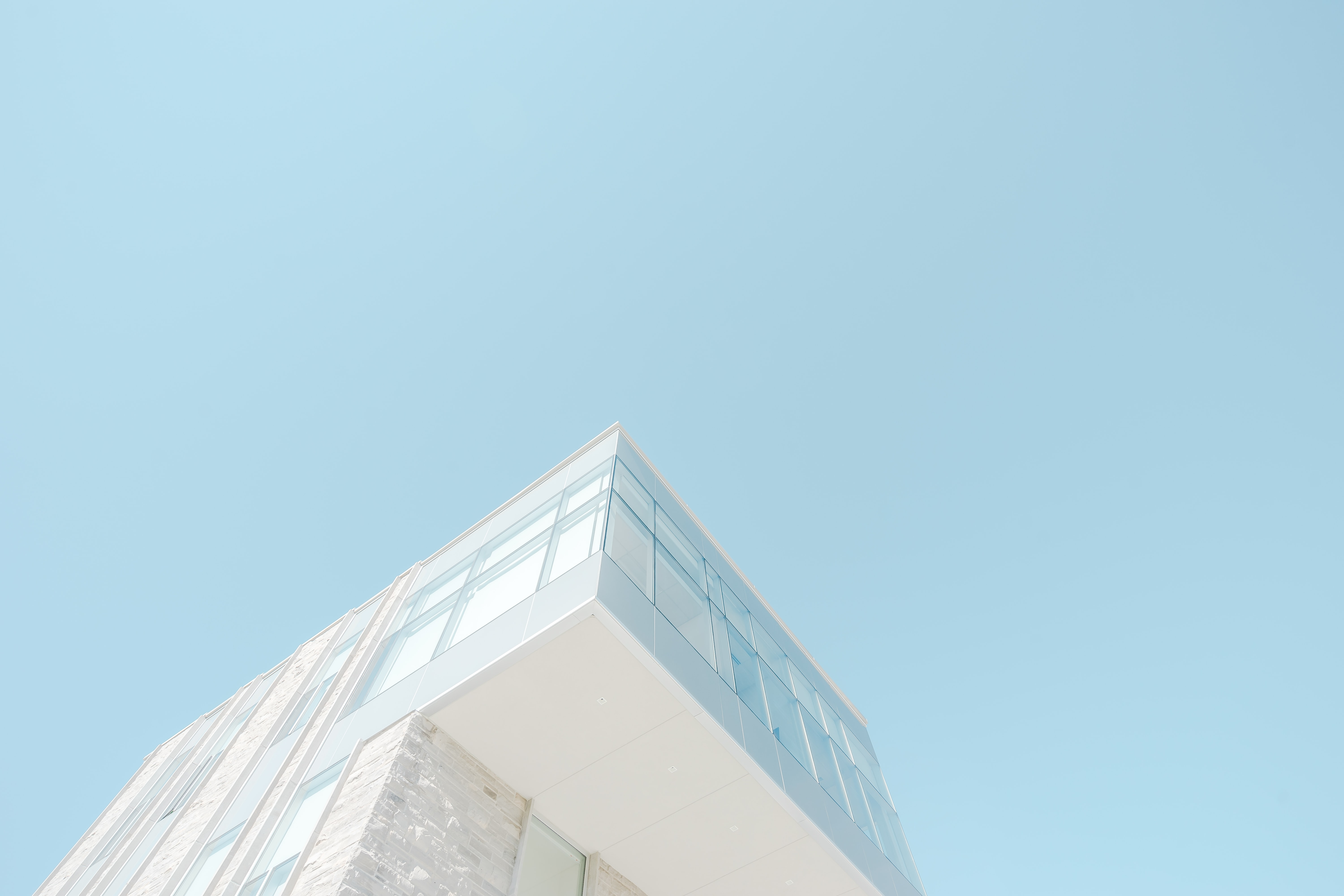low angle photograph of white concrete building