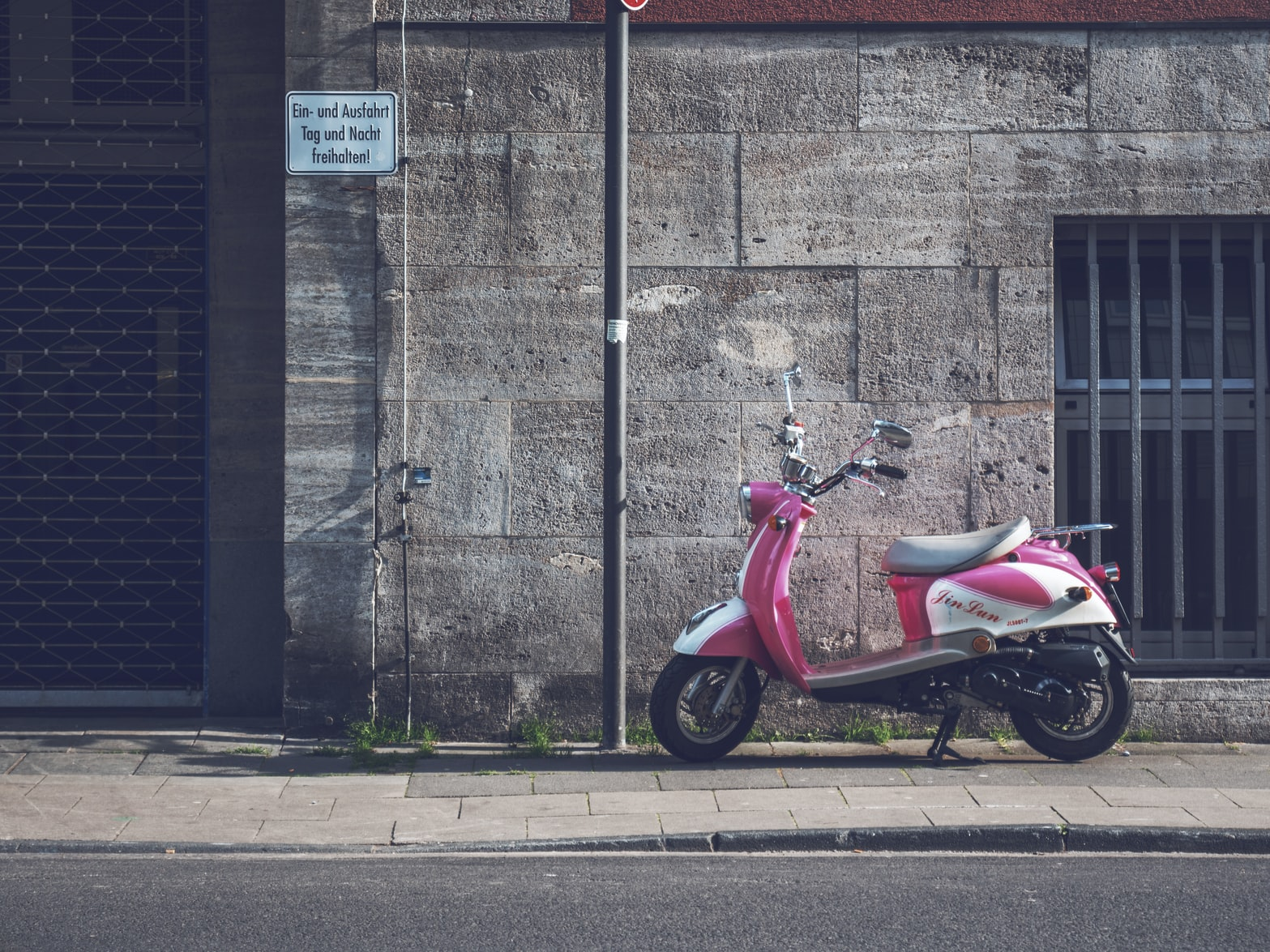 Pink scooter parked