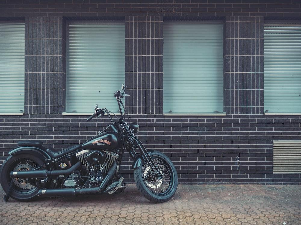 black chopper motorcycle beside building