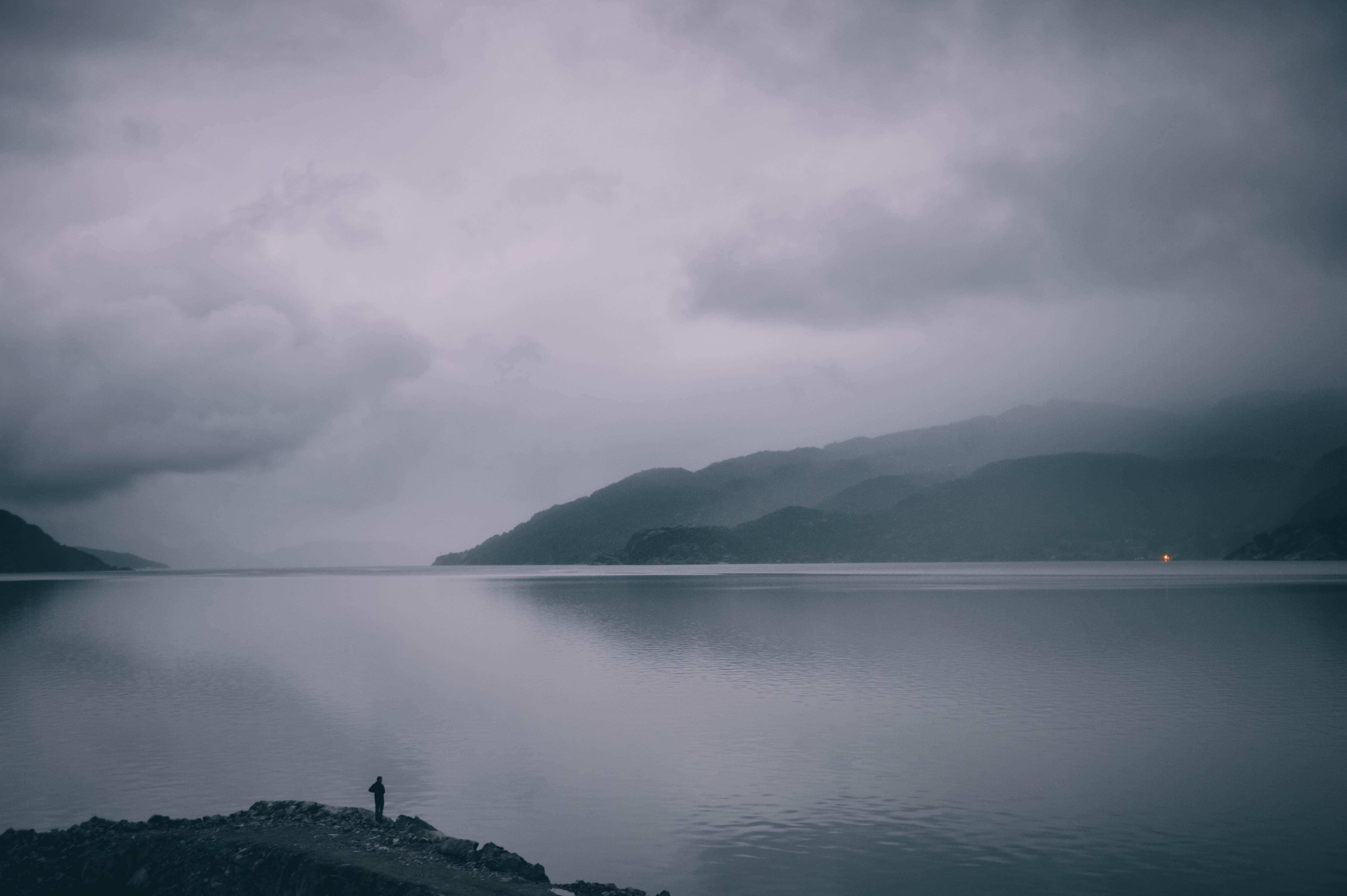 man standing on gray mountain