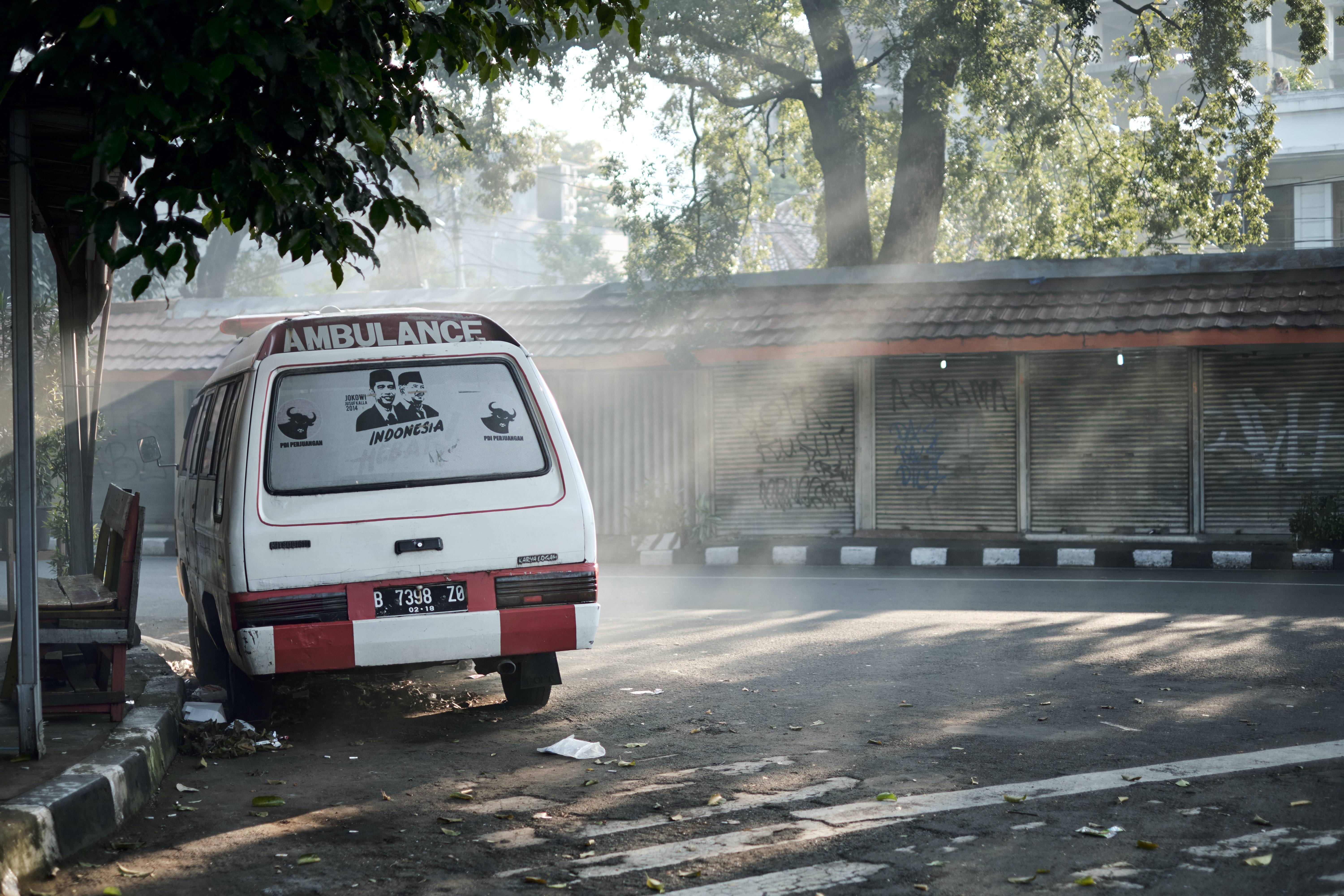 Ambulance van parked on an abandoned street in Jakarta