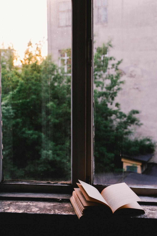 book near glass window