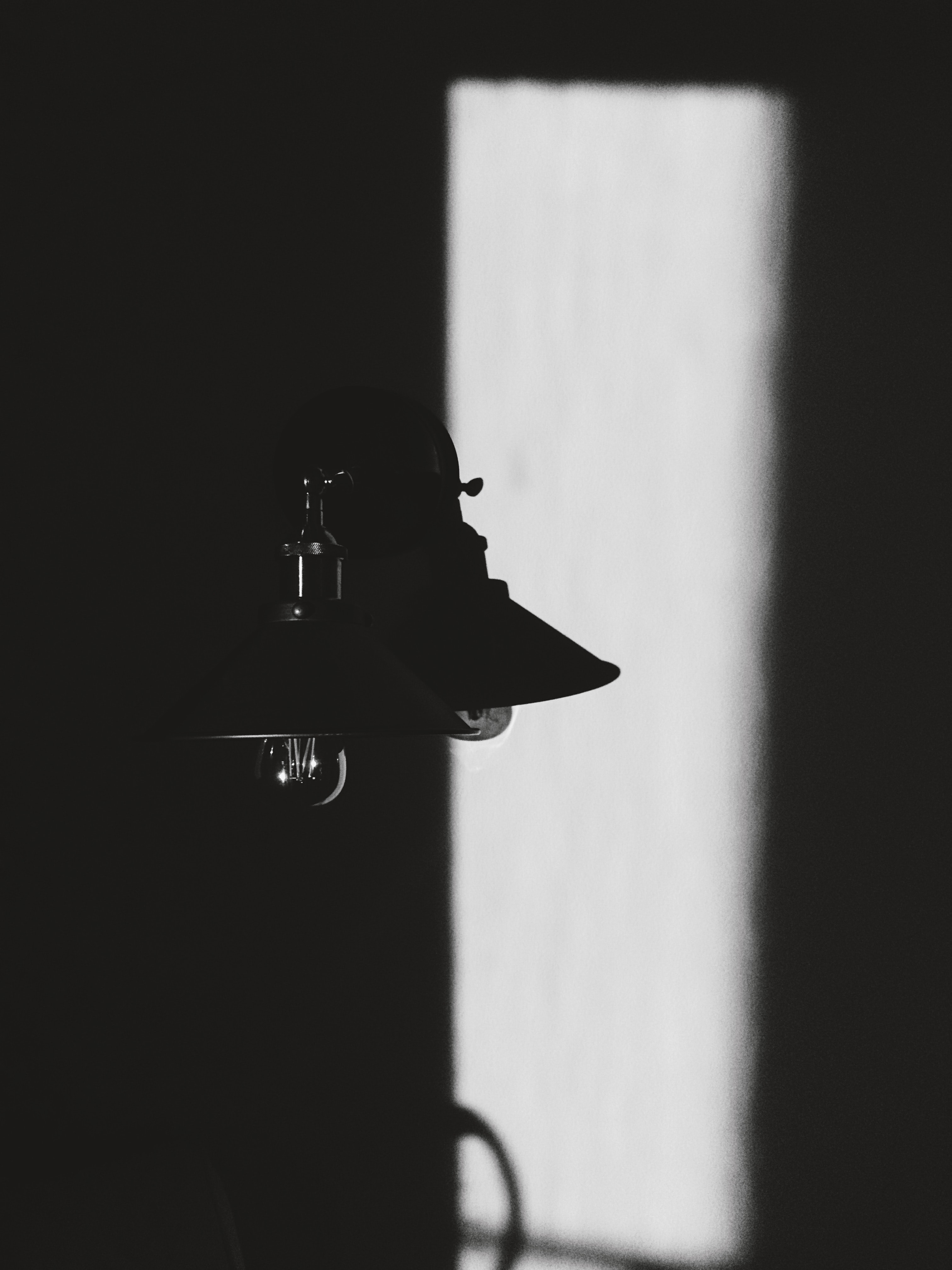 Black and white shot of vintage light lamp with shadow, Schaumburg, Illinois, United States
