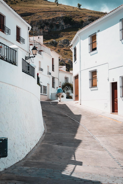 man walking near houses