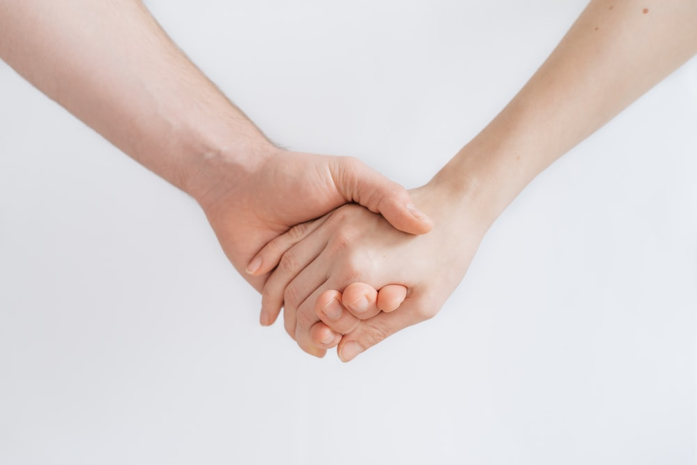 woman and man holding hands