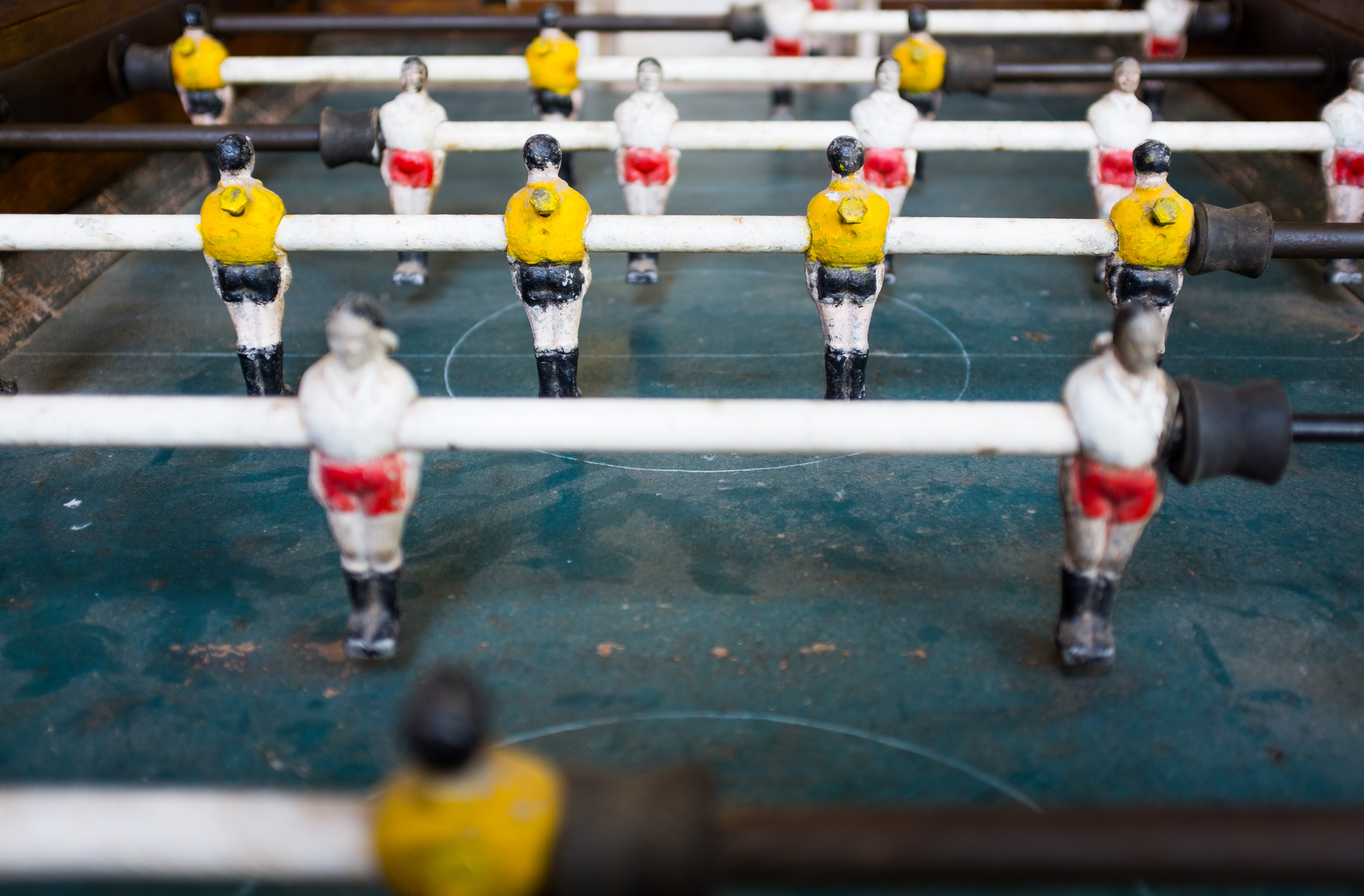 selective focus photography foosball table