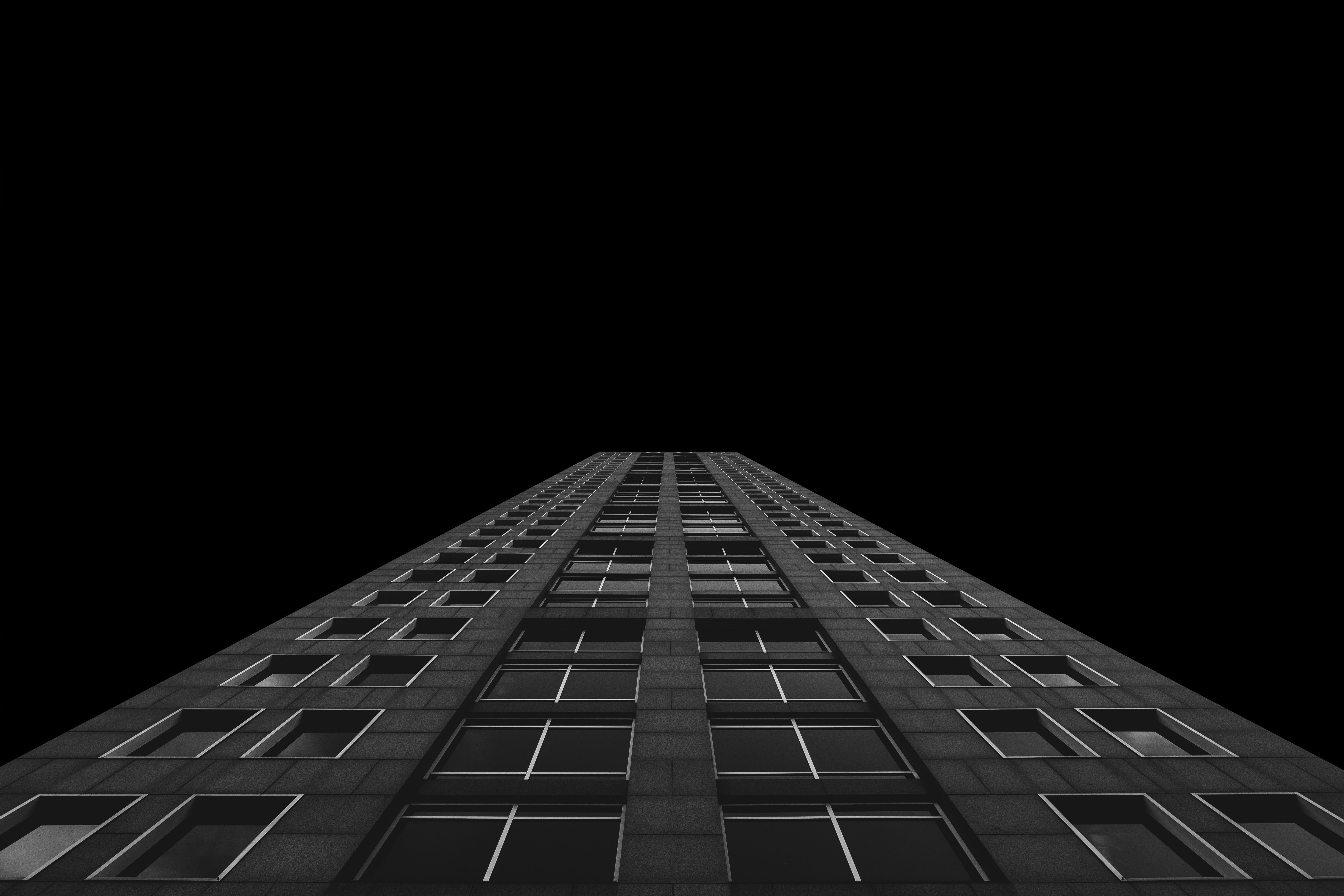worm's eye view photo of building during night time
