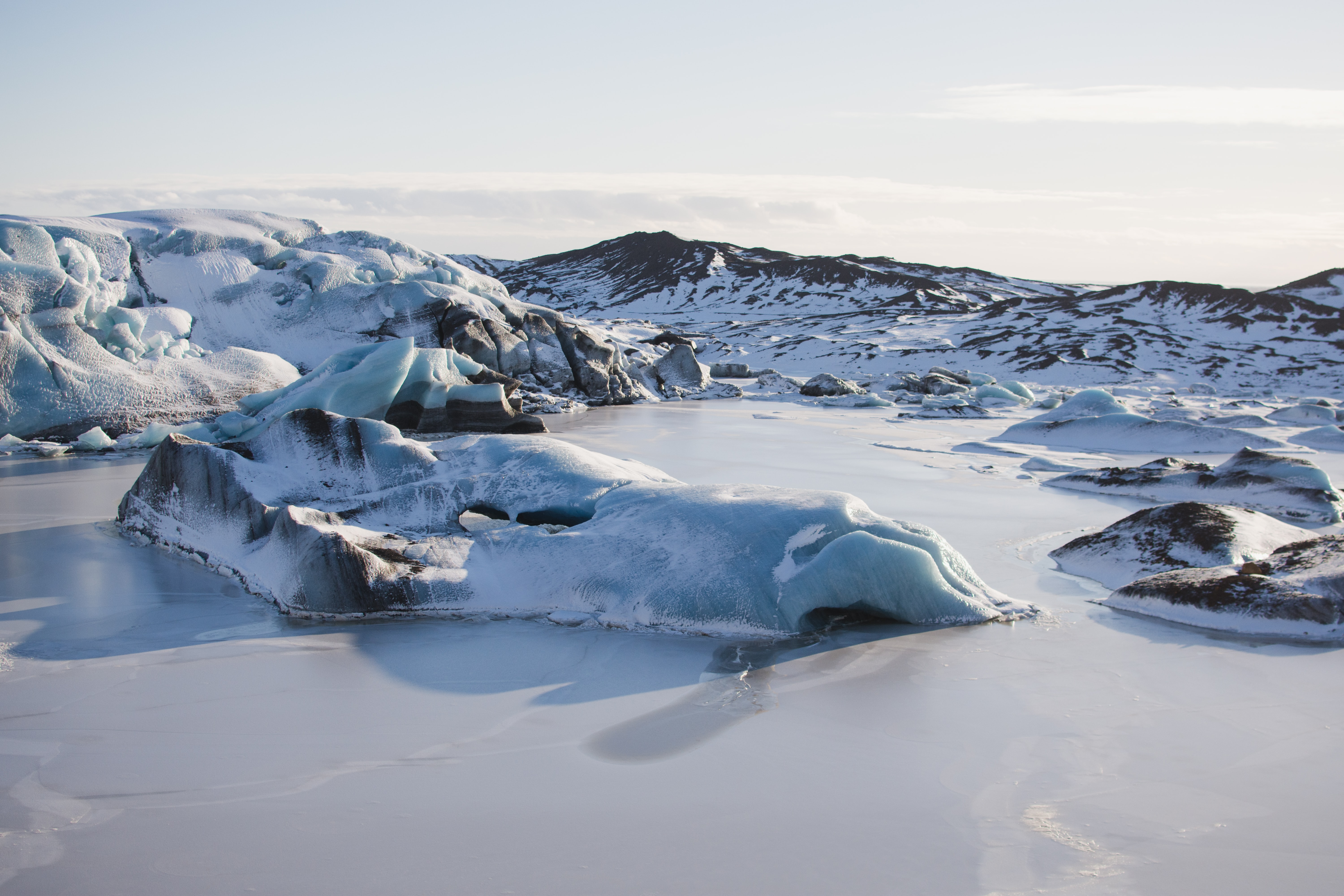 The surface of the glacier with a smooth frozen pool of water