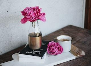 pink petaled flower on bottle
