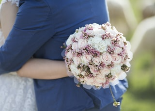 person holding rose bouquet