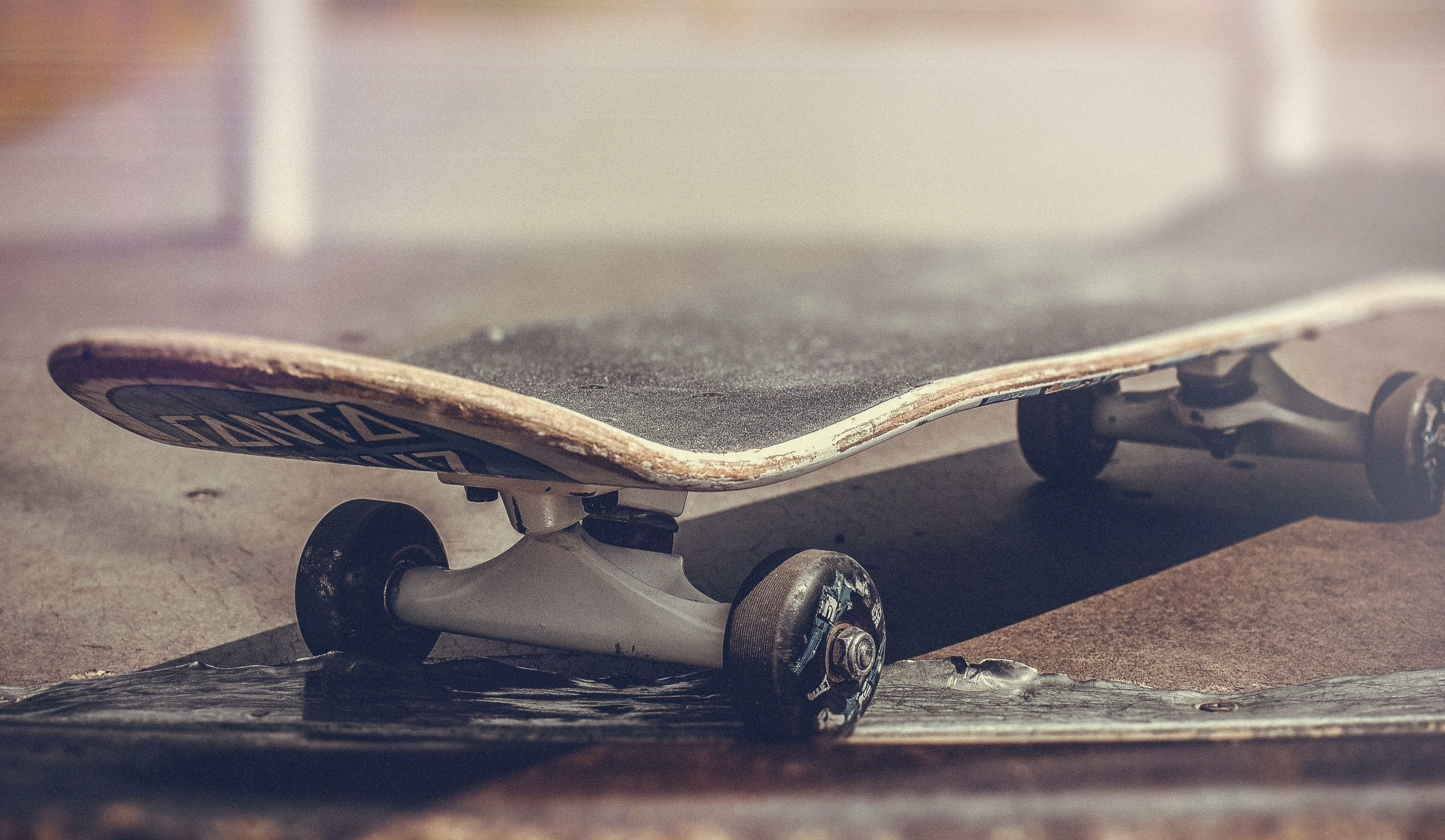 A skateboard at the edge of a step with a vintage filter