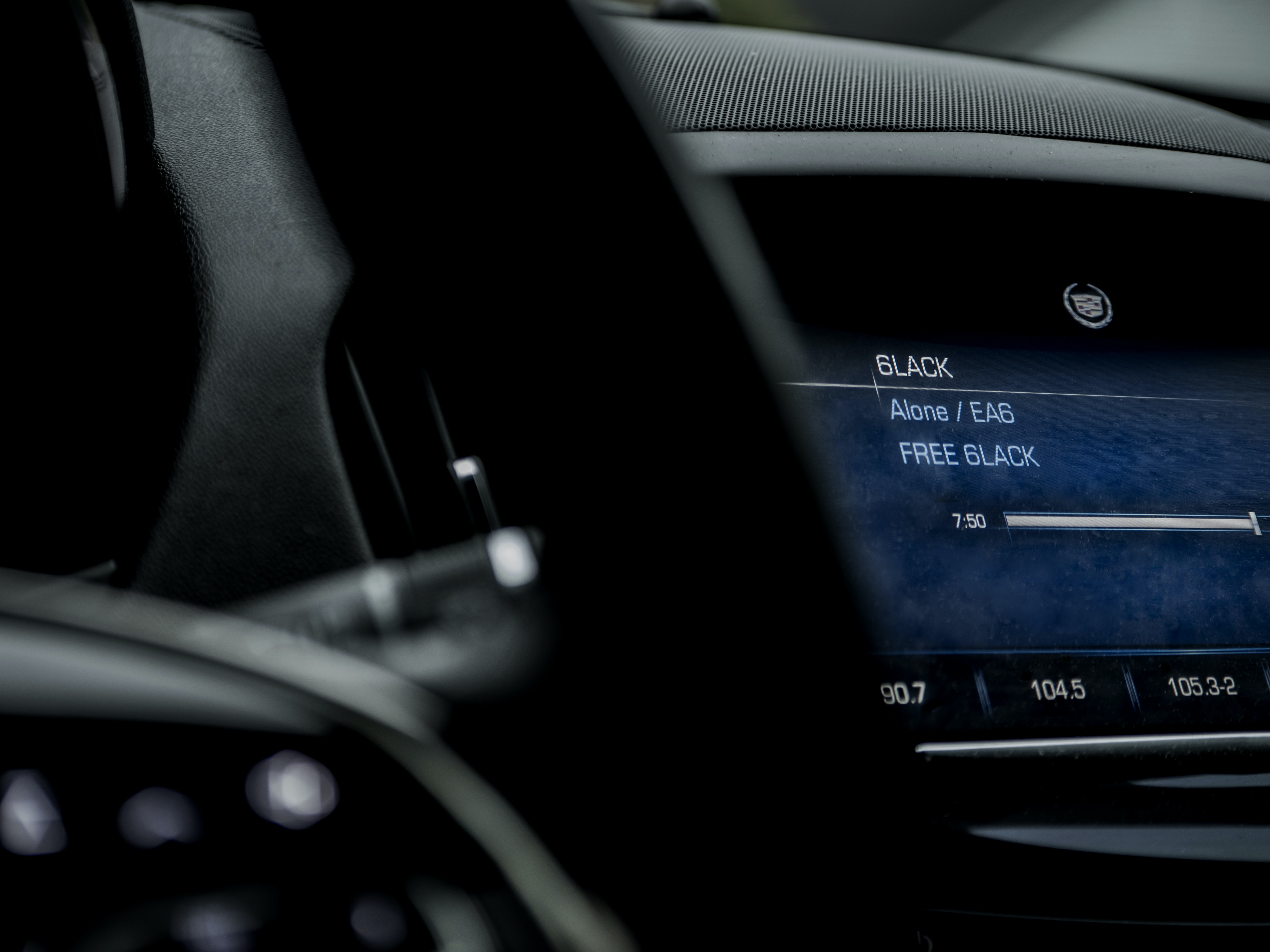Macro of Cadillac car dashboard and screen with communication technology