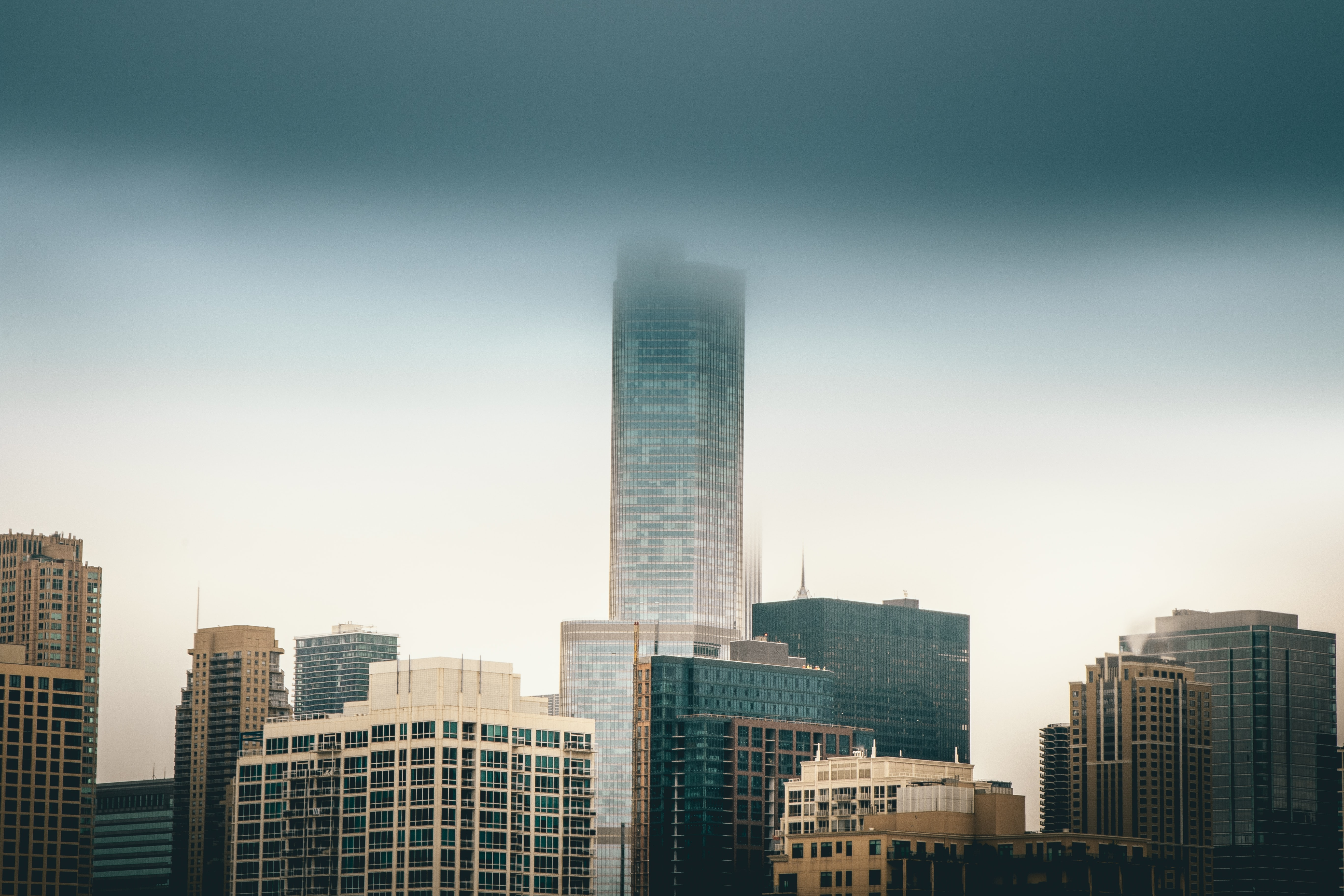 Skyscrapers and high-rises in a city on a foggy day