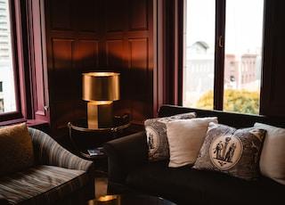 two sofa near windows
