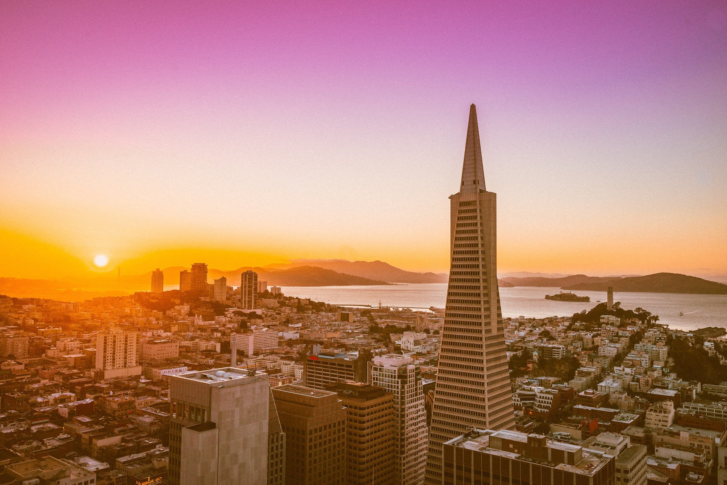 The skyline of San Francisco with the Transamerica Pyramid Center during sunset.