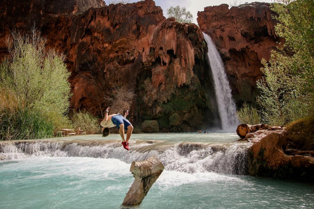 Waterfall into mountain pond