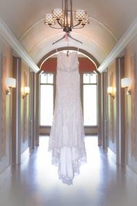 white spaghetti strap dress hang on chandelier