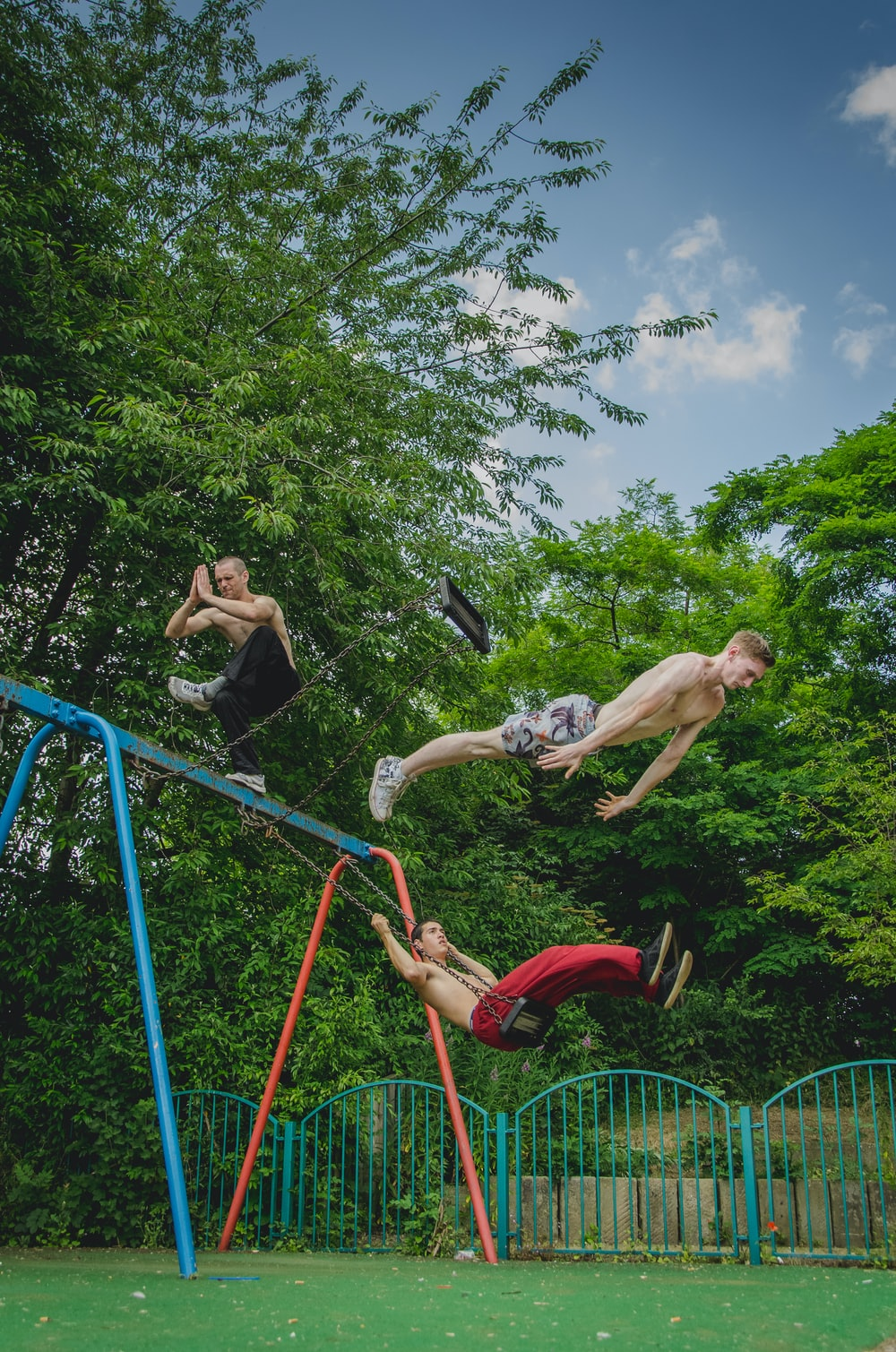 Older boys meditating and jumping off a swing set.