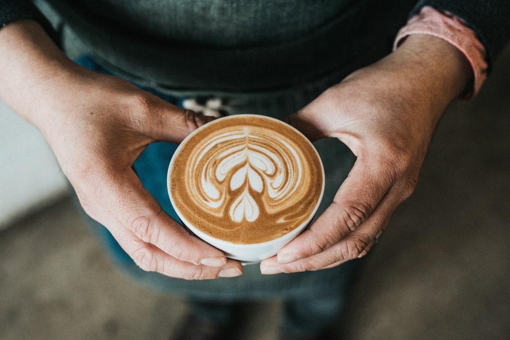 focus photography of coffee artwork