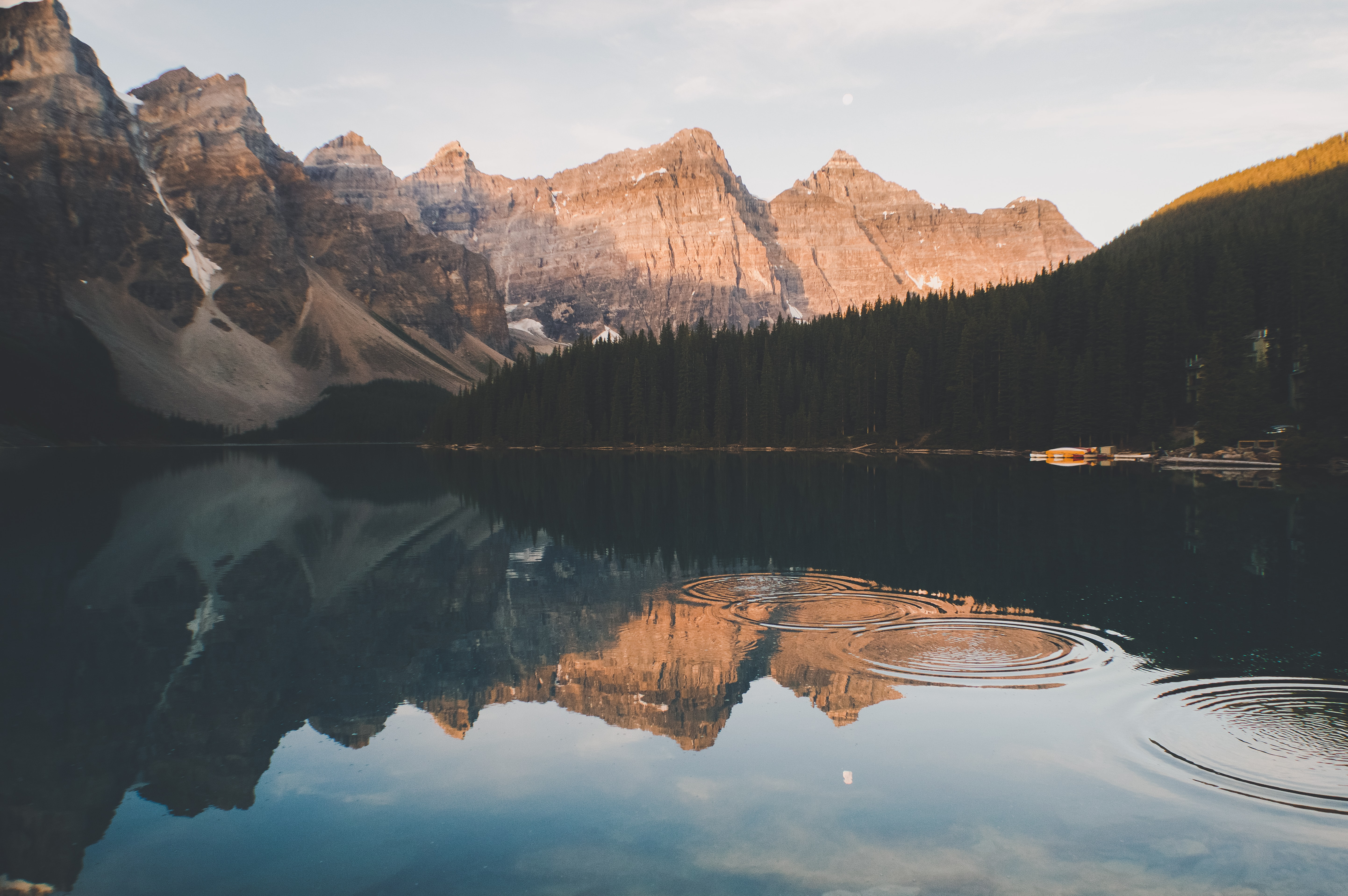 Ripples on the surface of a lake with a view on tall mountains
